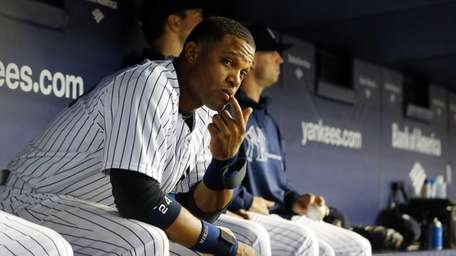 Robinson Cano of the Yankees looks on from
