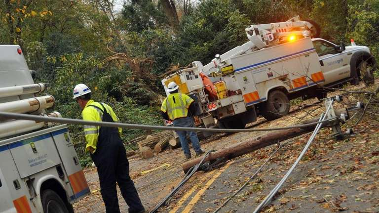 National Grid workers assess roads in Lattingtown for