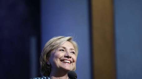 Former Secretary of State Hillary Rodham Clinton, smiles