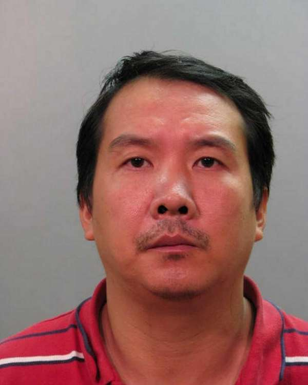 Dianjeng Jiang, 41, was arrested outside his Melville