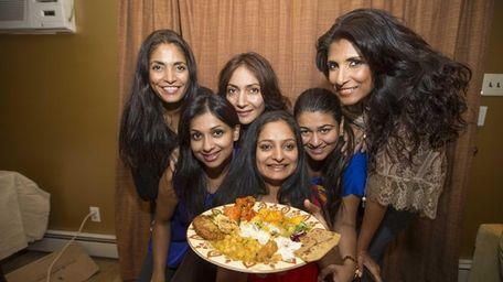 Members of the Masala Mamas, from left, Deepa