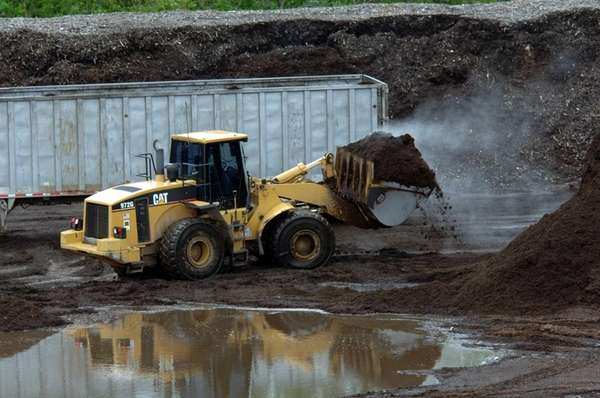 A bulldozer works at the site of one