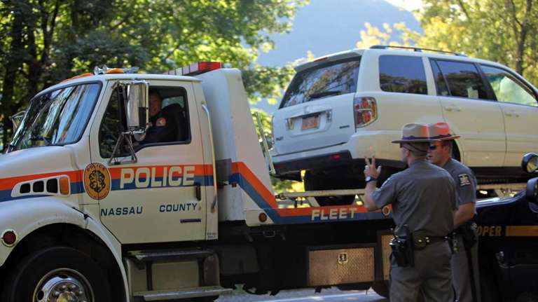 A Nassau County Police flatbed tow-truck takes a