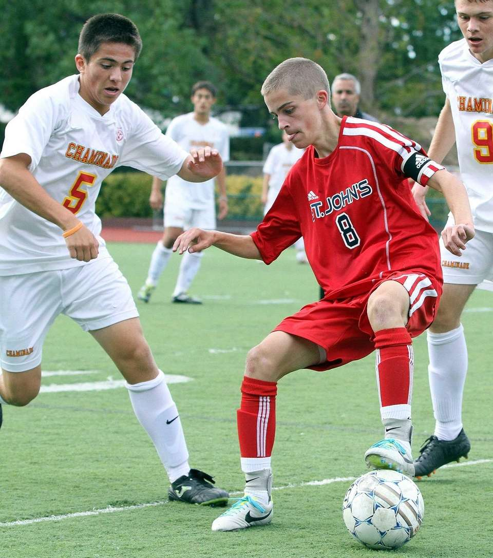 St. John the Baptist's Kieran Hall controls the