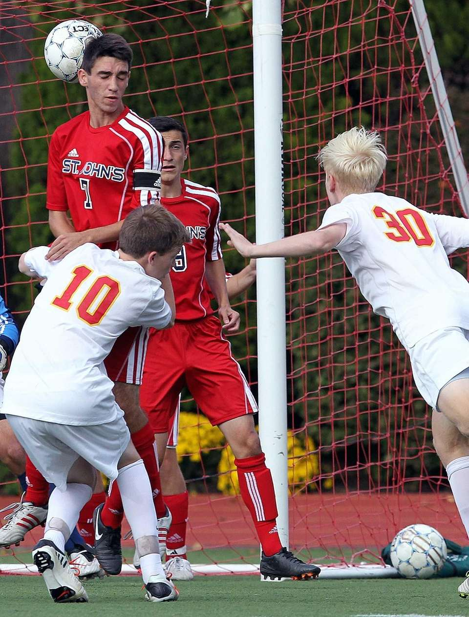 Chaminade's James Brady scores with a header against