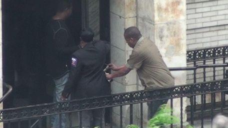 Surveillance shows individuals allegedly involved in a scheme