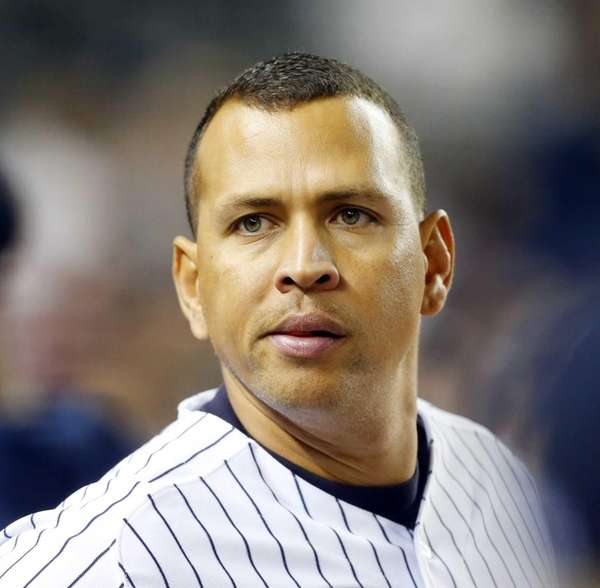 Alex Rodriguez looks on from the dugout during