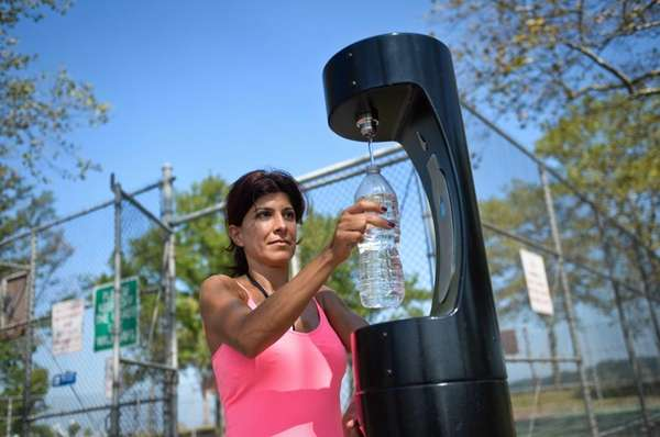 Roya Baron, of Great Neck, fills her water