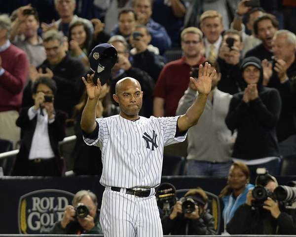 Yankees pitcher Mariano Rivera waves to fans for