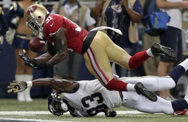 San Francisco 49ers safety Donte Whitner, top, intercepts