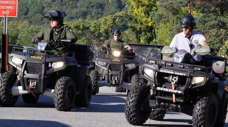 Police emerge from area near the Hudson River