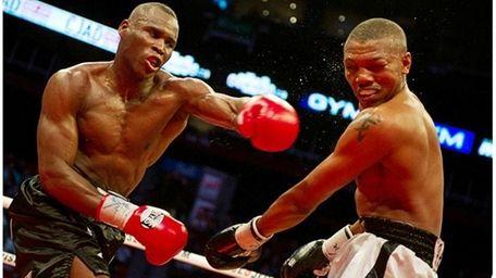 Adonis Stevenson, left, lands a punch against Chad