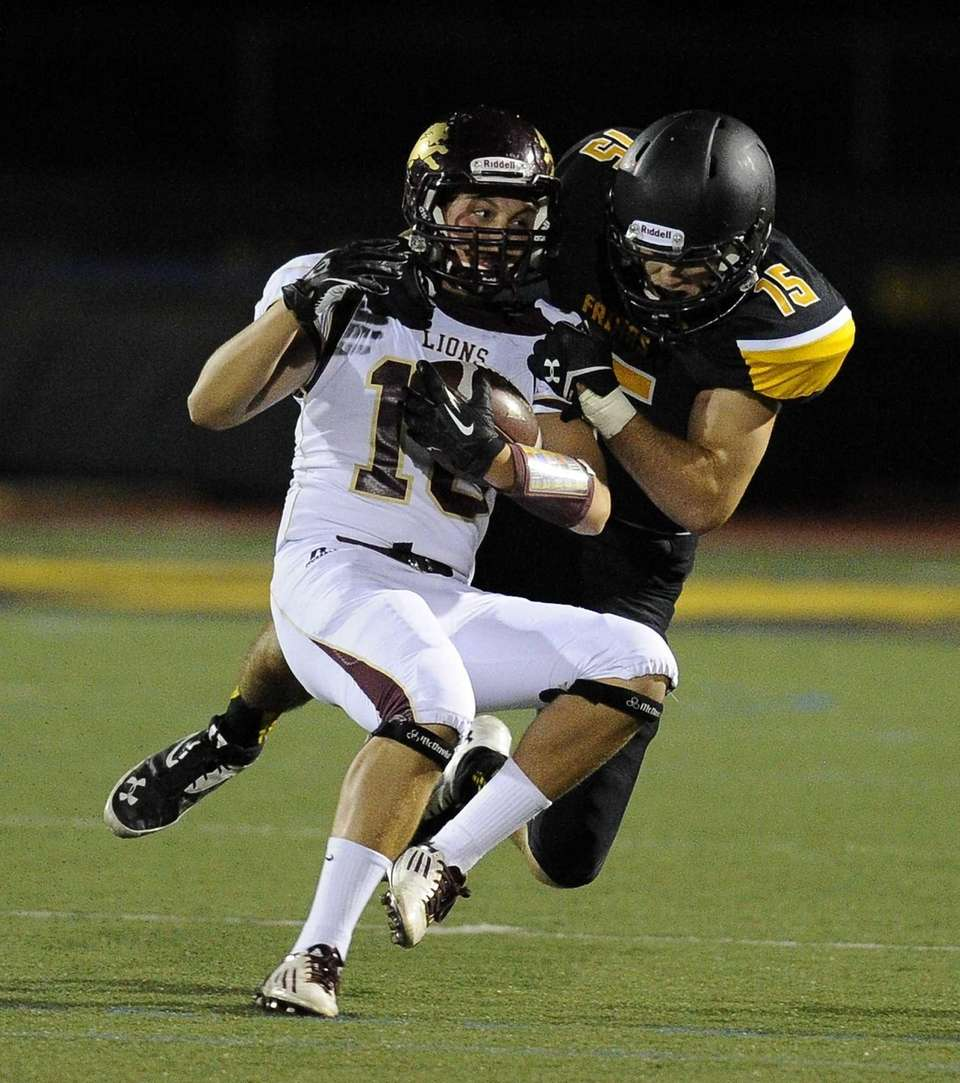 St. Anthony's defensive back Ryan Bonomi tackles Monsignor