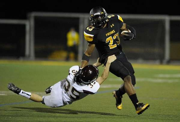 St. Anthony's linebacker Esteban Sarmiento is tackled by