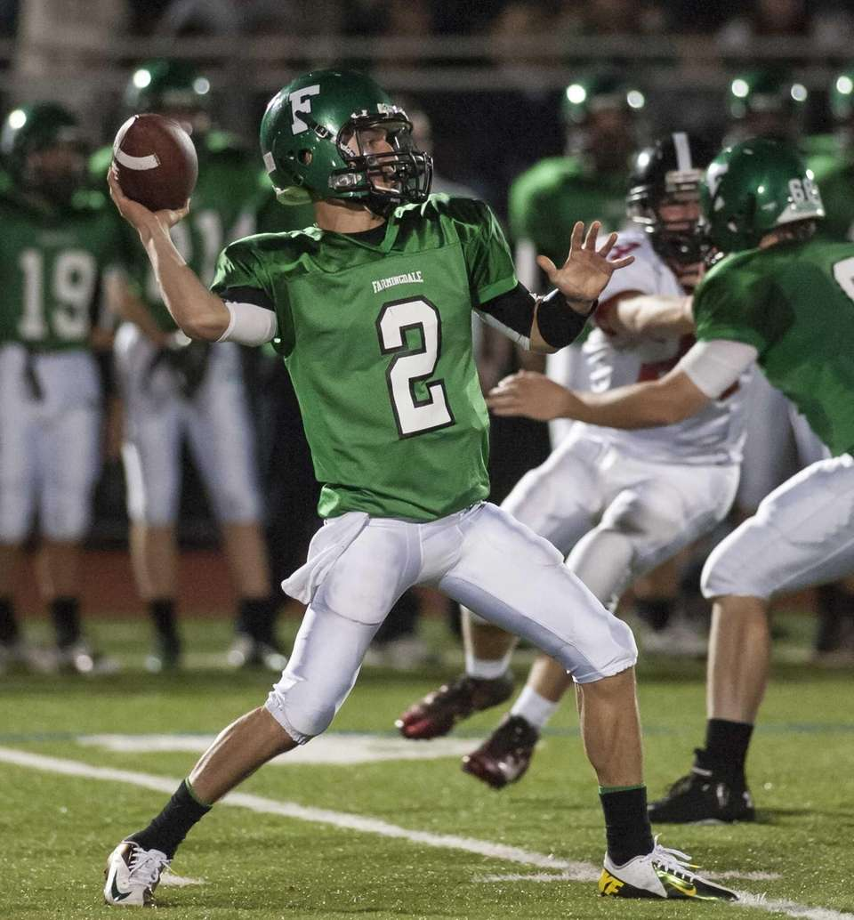 Farmingdale's Vinny Quinn gets set to throw a