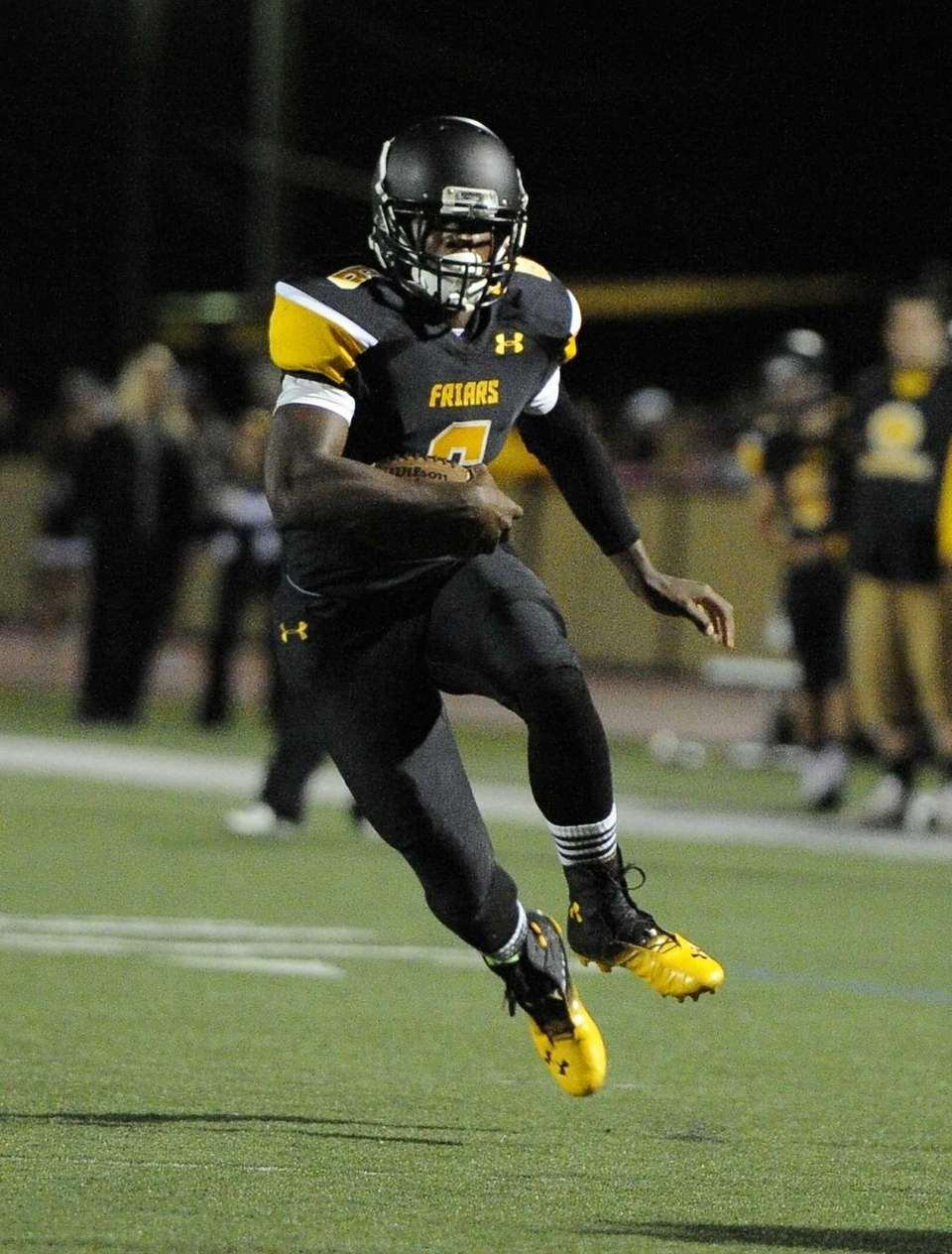 St. Anthony's running back Naim Jones drives the