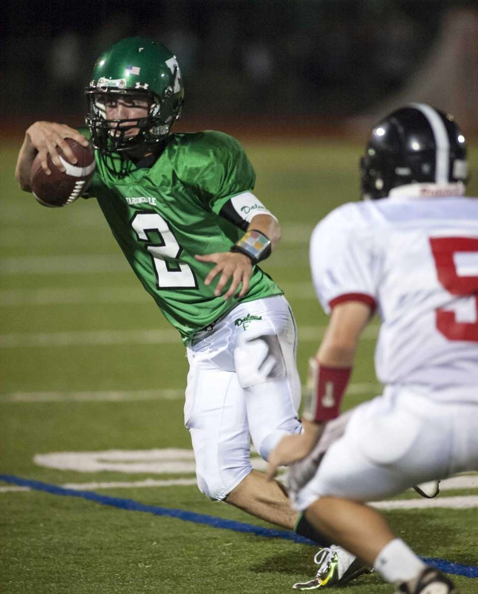 Farmingdale's Vinny Quinn, left, looks to get around