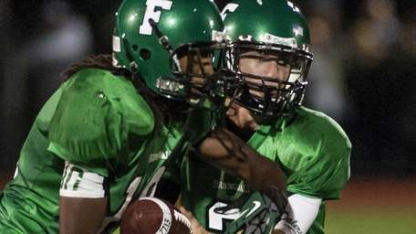 Farmingdale's Vinny Quinn, right, hands the ball off