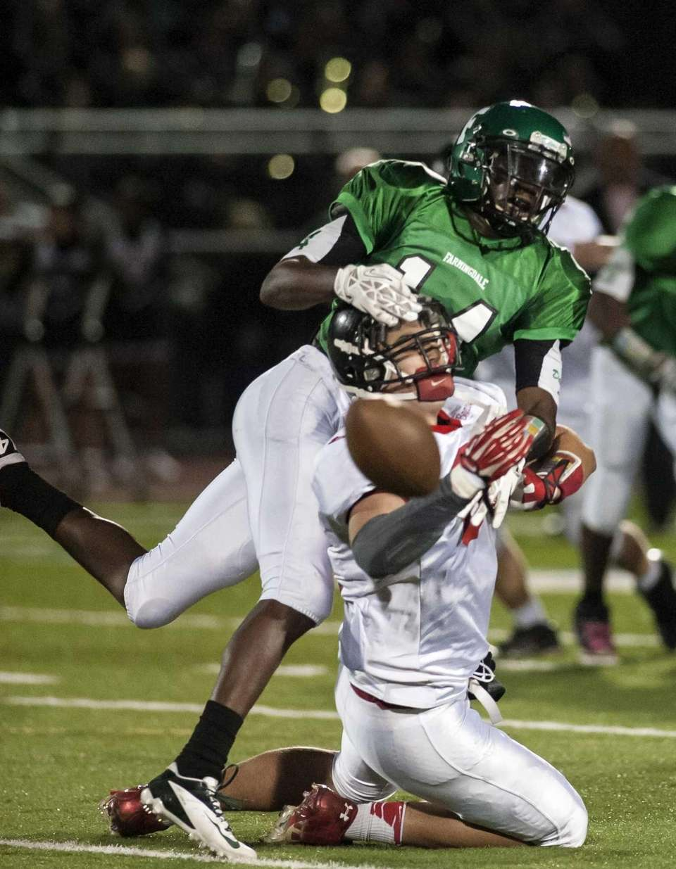 Farmingdale's Robert Jones, top, breaks up a pass