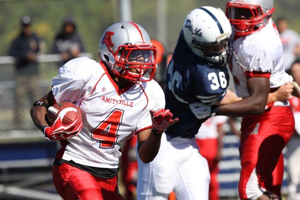 Amityville's Collin Koward runs the ball against Huntington
