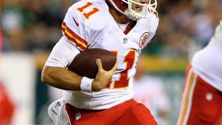 Kansas City Chiefs Alex Smith scrambles in the