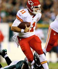 Kansas City Chiefs Alex Smith scrambles in the