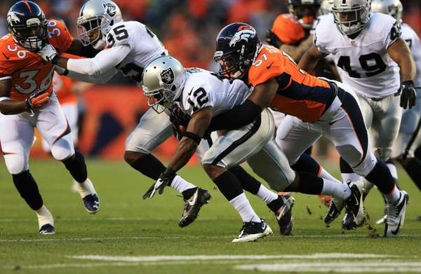 Oakland Raiders' Jacoby Ford is tackled by Denver