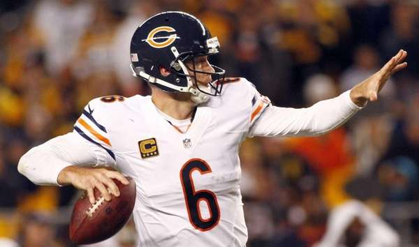 Chicago Bears quarterback Jay Cutler drops back to