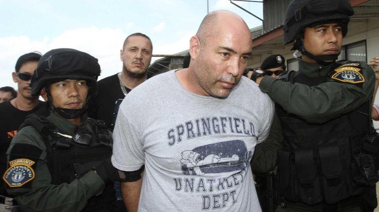 Joseph Manuel Hunter, center, is escorted by Thai