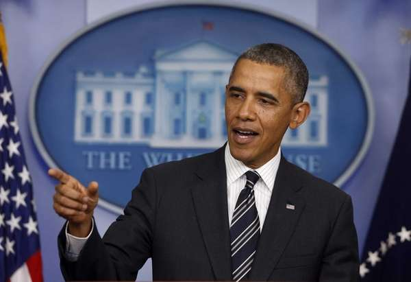 President Barack Obama gestures while making a statement