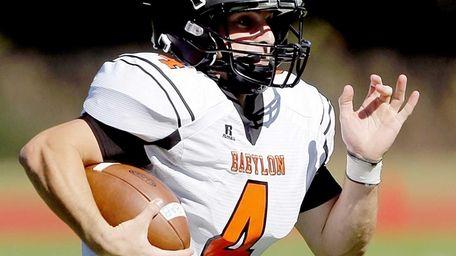 Babylon quarterback Nick Santorelli (4) runs around the