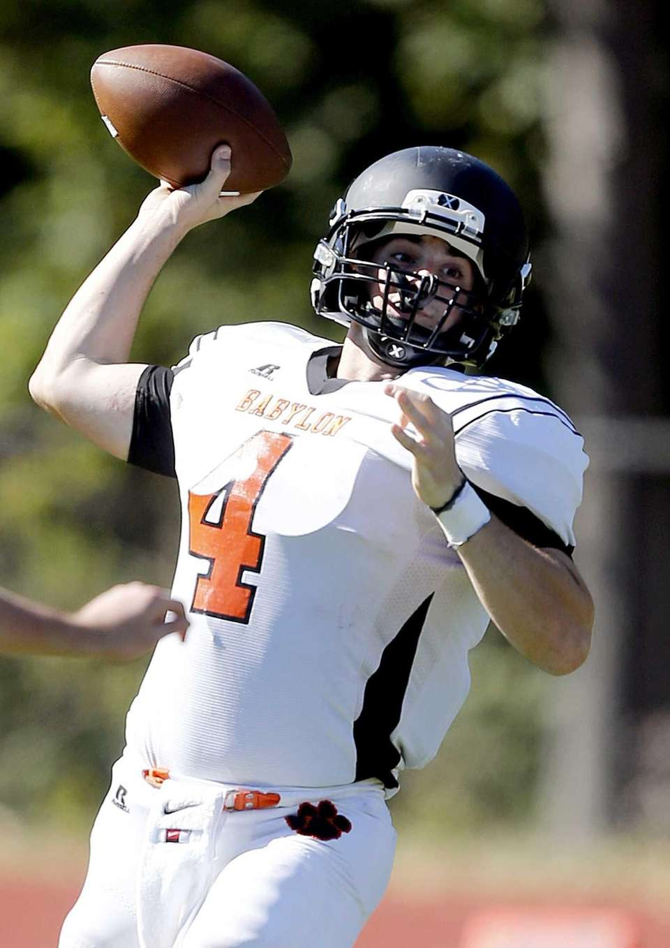 Babylon quarterback Nick Santorelli (4) throws from the