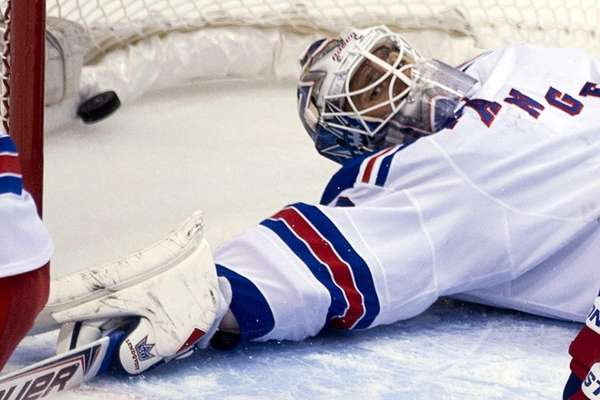 Rangers goalie Henrik Lundqvist looks on as a