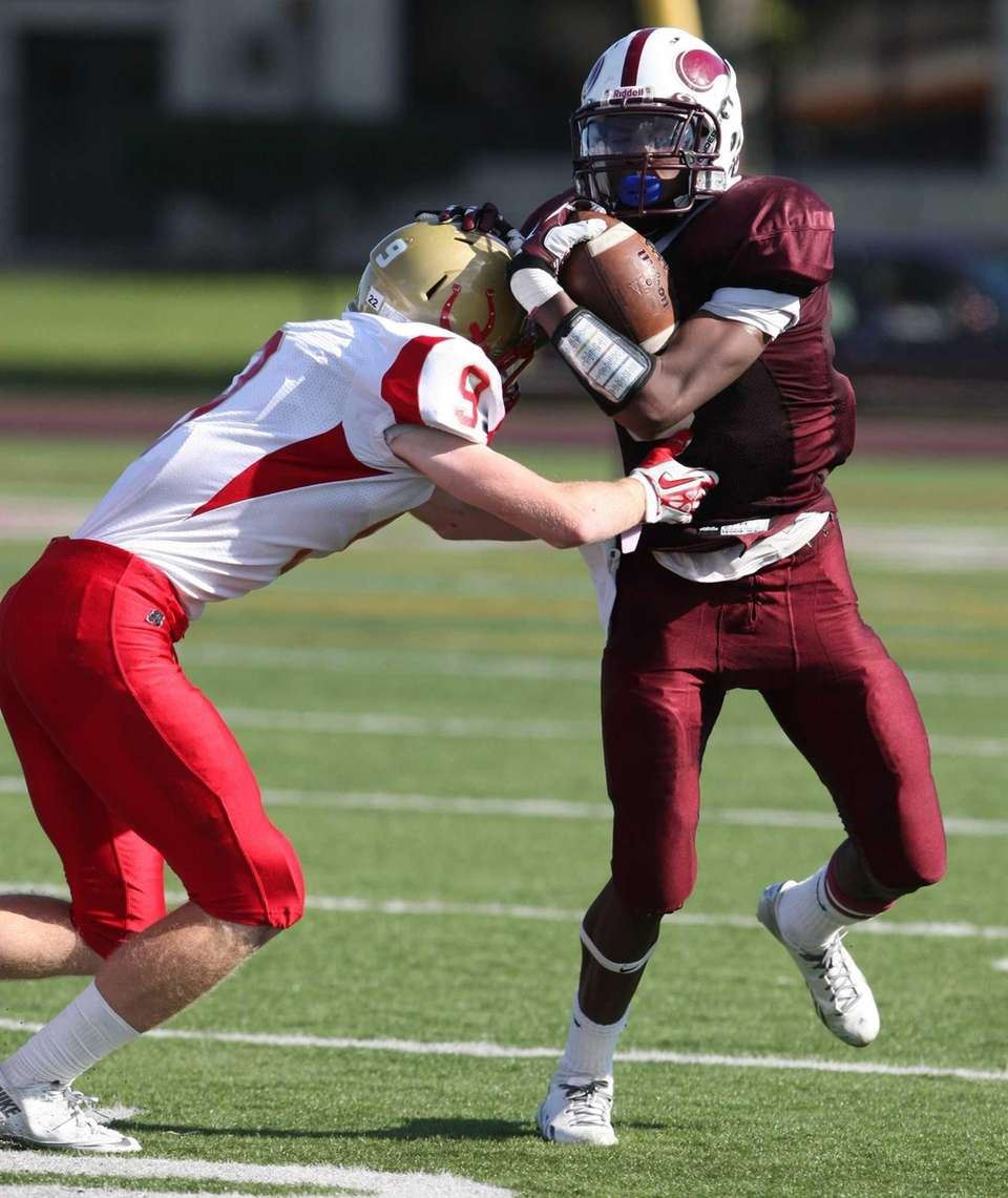 Bay Shore's Jaquan Moore, right, attempts to break