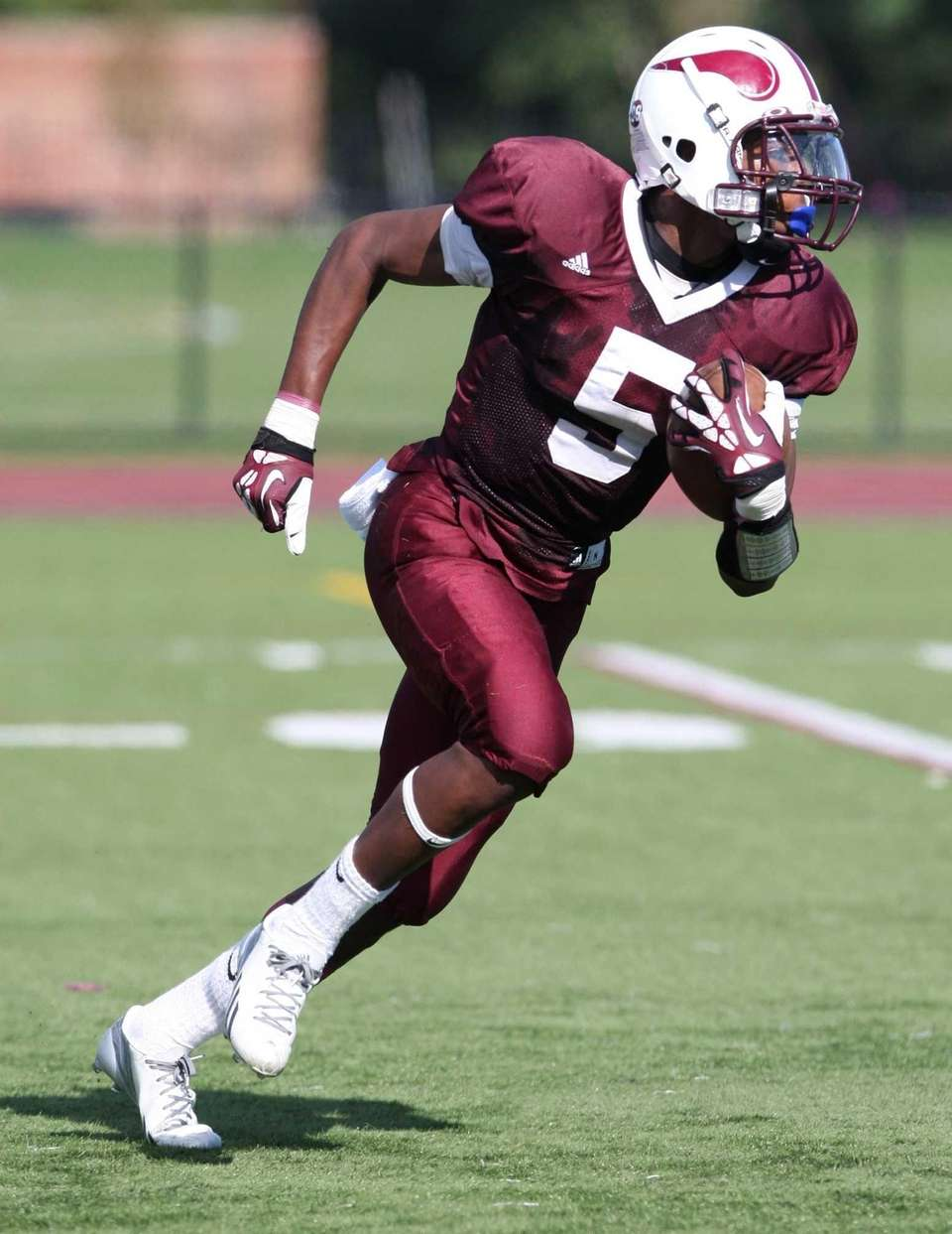 Bay Shore's Jaquan Moore fields a punt and
