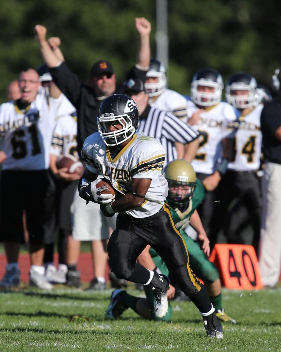 Sachem North's Kevin Bragaglia (no. 21) catches a
