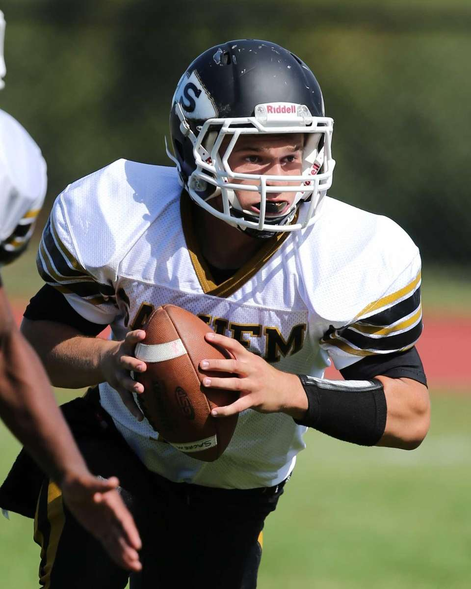 Sachem North quarterback Trent Crossan runs an option