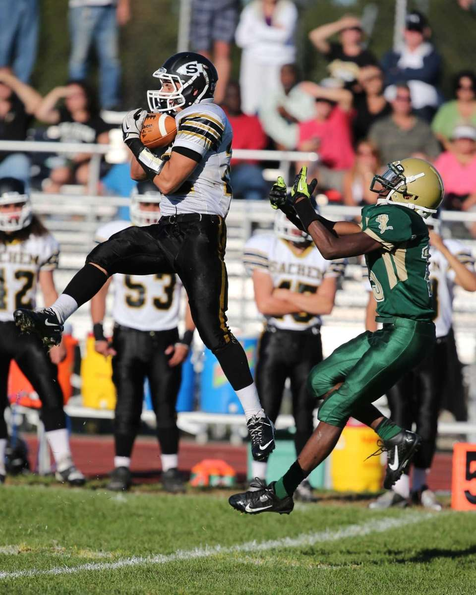 Sachem North linebacker Chris Biryla (left) intercepts a