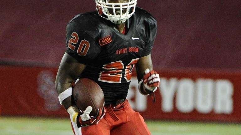 Stony Brook running back Jameel Poteat carries the