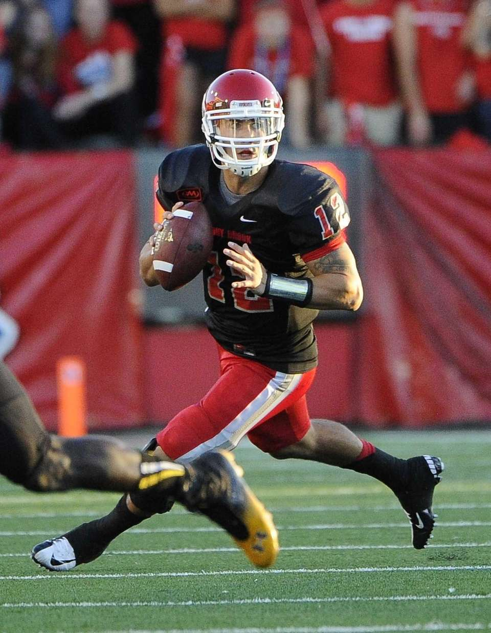 Stony Brook quarterback Lyle Negron looks to pass