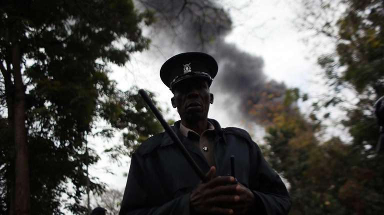 A Kenyan security officer standing guard as heavy