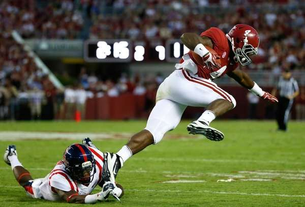 Alabama running back T.J. Yeldon leaps over a