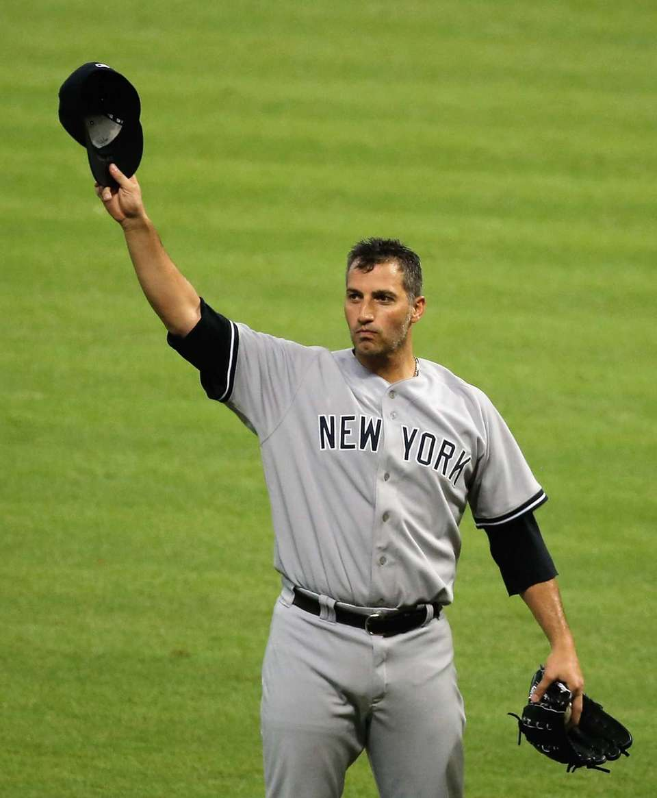 Andy Pettitte celebrates after pitching his last game
