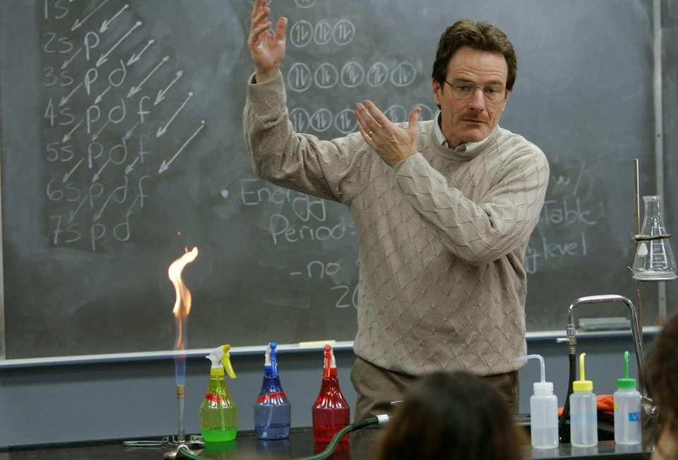 Walter White (Bryan Cranston) teaches chemistry class in
