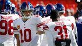 Eli Manning (10) greets cornerback Aaron Ross (31)
