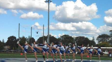 The Division Avenue High School kickline performs at