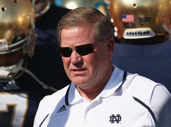 Notre Dame head coach Brian Kelly waits to