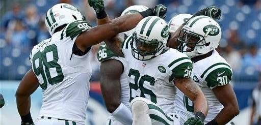 Jets players Quinton Coples (98), Dawan Landry (26)