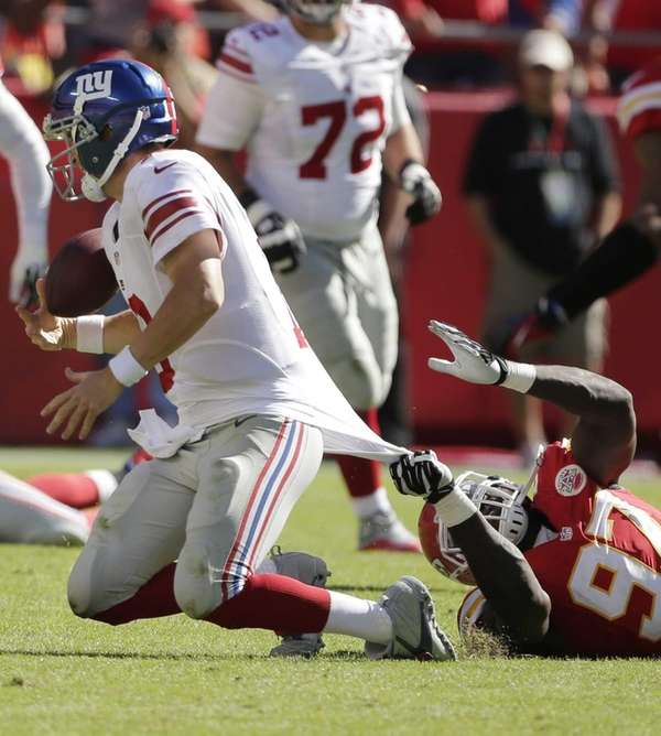 Giants quarterback Eli Manning (no. 10) is tackled