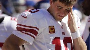 Giants quarterback Eli Manning stands on the sideline